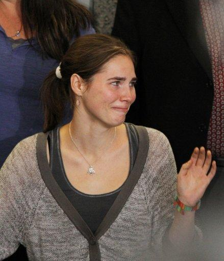<p>Amanda Knox waves to supporters after arriving in Seattle following her release from custody in Italy, on October 4, 2011. Knox and her Italian former boyfriend Raffaele Sollecito were originally sentenced to 26 and 25 years in prison for killing and sexually assaulting Meredith Kercher in 2007, but were acquitted on appeal after four years in prison.</p>
