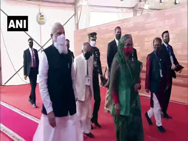 PM Narendra Modi, with his Bangladesh counterpart Sheikh Hasina, arrives at National Parade Ground in Dhaka to take in National Day programme.