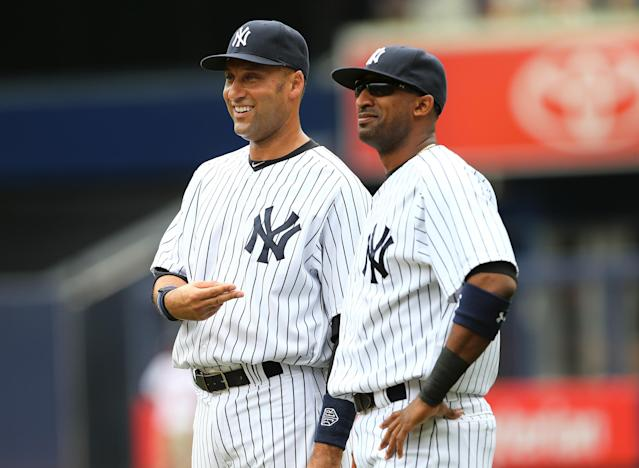 NEW YORK, NY - JULY 11: Derek Jeter #2 of the New York Yankees talks with Eduardo Nunez #26 before the game against the Kansas City Royals on July11,2013 at Yankee Stadium in the Bronx borough of New York City. (Photo by Elsa/Getty Images)