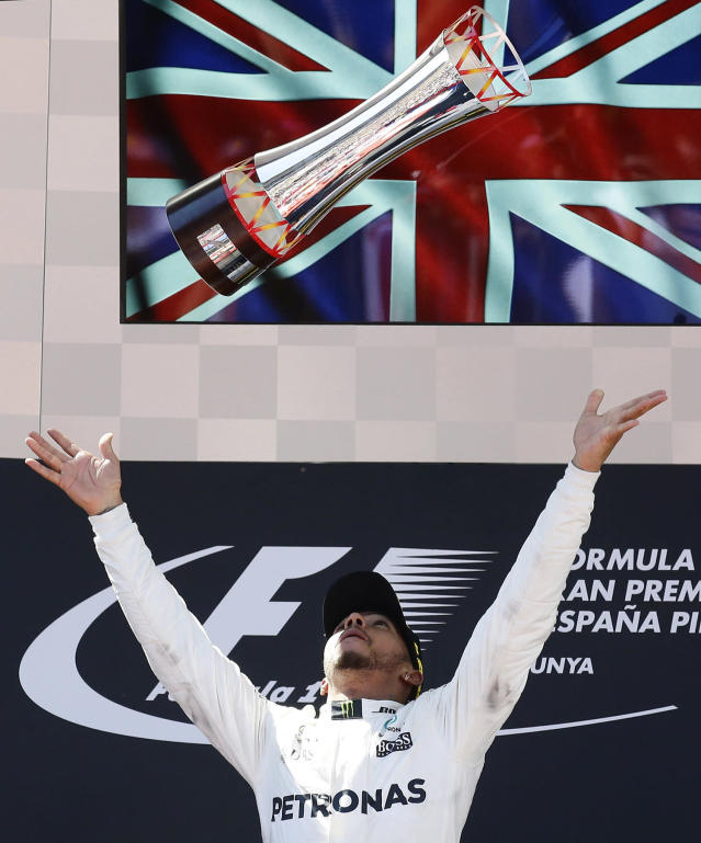 <p>Mercedes driver Lewis Hamilton of Britain throws his trophy into the air on the podium after winning the Spanish Formula One Grand Prix at the Barcelona Catalunya racetrack in Montmelo, Spain, Sunday, May 14, 2017. (Photo: Manu Fernandez/AP) </p>