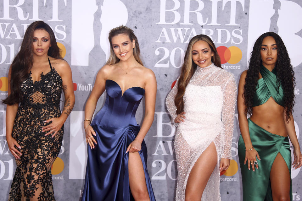Jesy Nelson, from left, Perrie Edwards, Jade Thirlwall and Leigh-Anne Pinnock from the band Little Mix pose for photographers upon arrival at the Brit Awards in London, Wednesday, Feb. 20, 2019. (Photo by Joel C Ryan/Invision/AP)