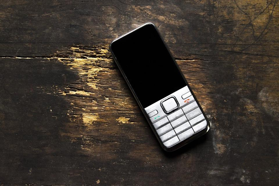 old burner phone on the table