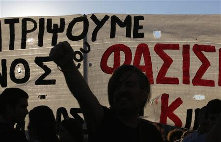 An anti-fascist protester raises his fist during a demonstration in Athens