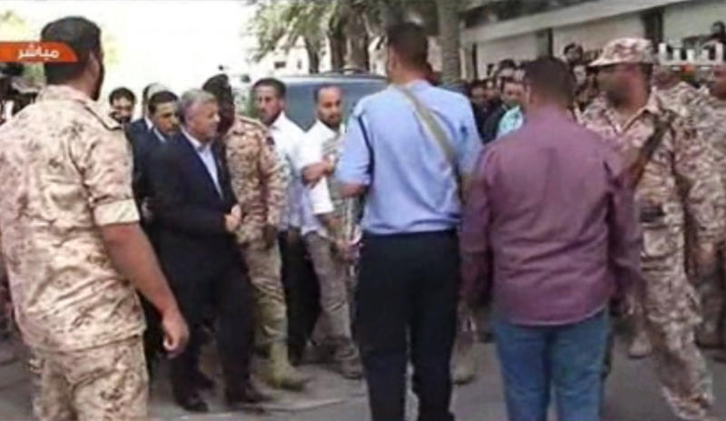 In this image made from video, Libyan Prime Minister Ali Zidan appears on a Libyan TV as he arrives at his cabinet office in the capital, Tripoli, Libya, Thursday, Oct. 10, 2013. Zidan has appeared in public for the first time since his release after being abducted by gunmen from his hotel earlier in the day. (AP Photo/AP Video)