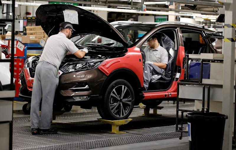 Workers are seen on the production line at Nissan's car plant in Sunderland: REUTERS