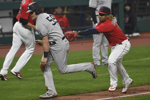 New York Yankees' Luke Voit (59) is tagged out by Cleveland Indians' Jose Ramirez during the fifth inning of Game 2 of an American League wild-card baseball series, Wednesday, Sept. 30, 2020, in Cleveland. (AP Photo/David Dermer)