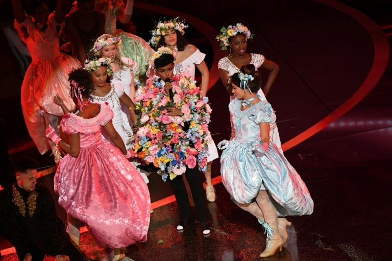 """Janelle Monae donned a wearable bouquet of floral garb inspired by the folk horror film """"Midsommar"""" as part of her opening of the 92nd Oscars"""