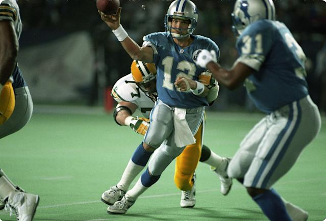 It's been 10,000 days since the Detroit Lions won a playoff game, led by QB Erik Kramer, center. (Getty Images)