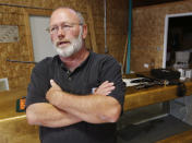 Jim Sowash stands in his gun shop near Stover, Mo., Thursday, June 20, 2013. Sowash signed a letter to Missouri Gov. Jay Nixon urging him to sign a bill nullifying federal gun laws. (AP Photo/Orlin Wagner)