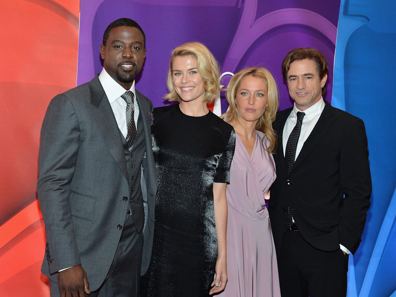 NEW YORK, NY - MAY 13: (L-R) Actors Lance Gross, Rachael Taylor, Gillian Anderson and Dermot Mulroney attend 2013 NBC Upfront Presentation Red Carpet Event at Radio City Music Hall on May 13, 2013 in New York City.  (Photo by Slaven Vlasic/Getty Images)