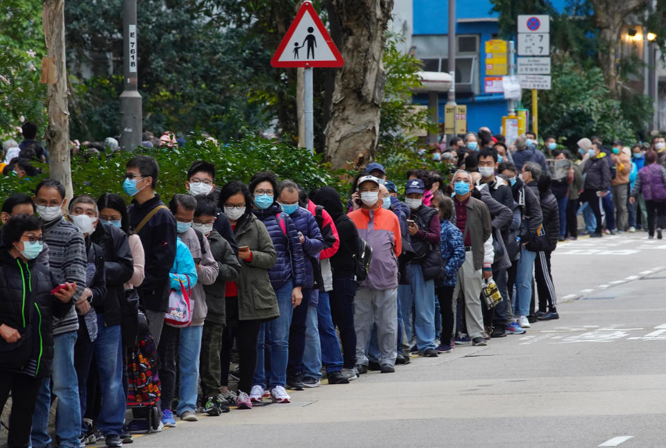FILE - In this Feb. 5, 2020, file photo, citizens line up to buy face masks in Hong Kong. Fear of the spreading coronavirus has led to a global run on sales of face masks despite medical experts' advice that most people who aren't sick don't need to wear them. (AP Photo/Vincent Yu, File)