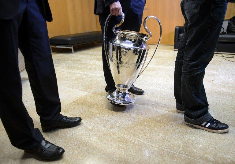 A picture taken on December 20, 2012 at UEFA headquarters in Nyon shows the Champions League trophy