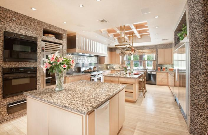 """<p>The large granite kitchen includes double, triple and/or quadruple everything, including islands, ovens, dishwashers, sinks and refrigerators. (All photos via <a href=""""http://bit.ly/1OjQdjg"""" rel=""""nofollow noopener"""" target=""""_blank"""" data-ylk=""""slk:Concierge Auctions listing"""" class=""""link rapid-noclick-resp"""">Concierge Auctions listing</a>)</p>"""