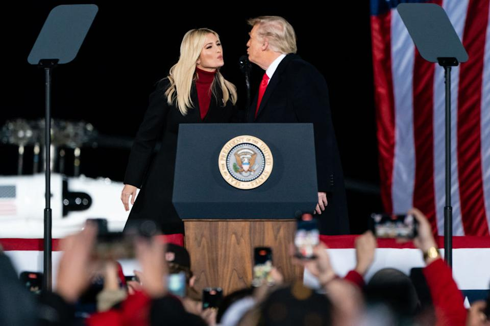 U.S. President Donald Trump prepares to kiss Ivanka Trump, senior adviser to President Trump, as she joins him on stage at a rally. Source: Getty