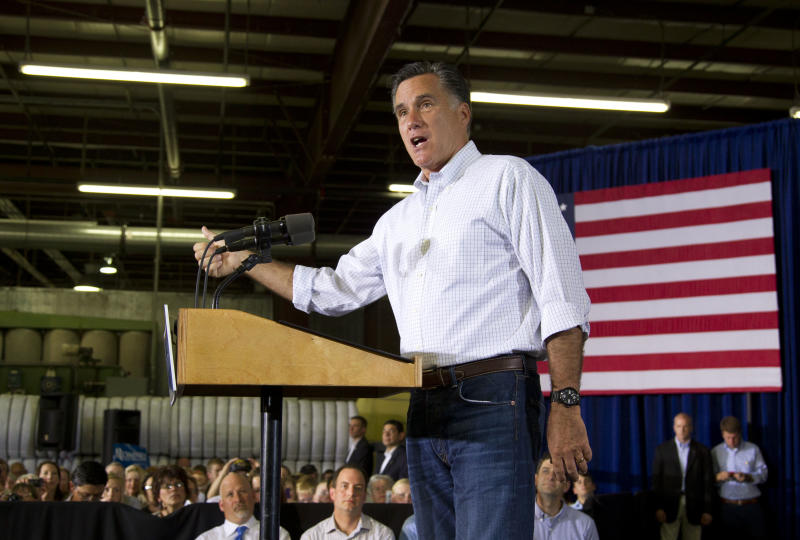 Republican presidential candidate, former Massachusetts Gov. Mitt Romney, gestures during a campaign stop at Monterey Mills on Monday, June 18, 2012 in Janesville, Wis.  (AP Photo/Evan Vucci)