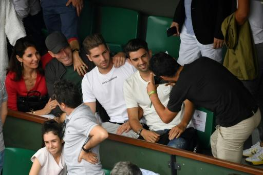 Cheese: French football legend Zinedine Zidane poses for a photo with his family in the stands