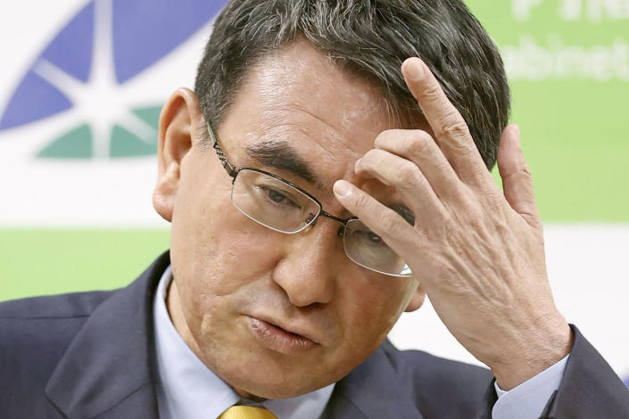 """Japan's COVID-19 Vaccine Minister Taro Kono scratches his forehead during a press conference on coronavirus vaccination, in Tokyo Wednesday, June 23, 2021. Kono abruptly announced a temporary suspension of all reservations for mass inoculations, saying vaccine distribution cannot keep pace with demand. He described the situation as """"being on a tightrope."""" (Kyodo News via AP)"""