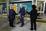 President Joe Biden shakes a persons hand as he tours the Cuyahoga Community College Manufacturing Technology Center, Thursday, May 27, 2021, in Cleveland. (AP Photo/Evan Vucci)
