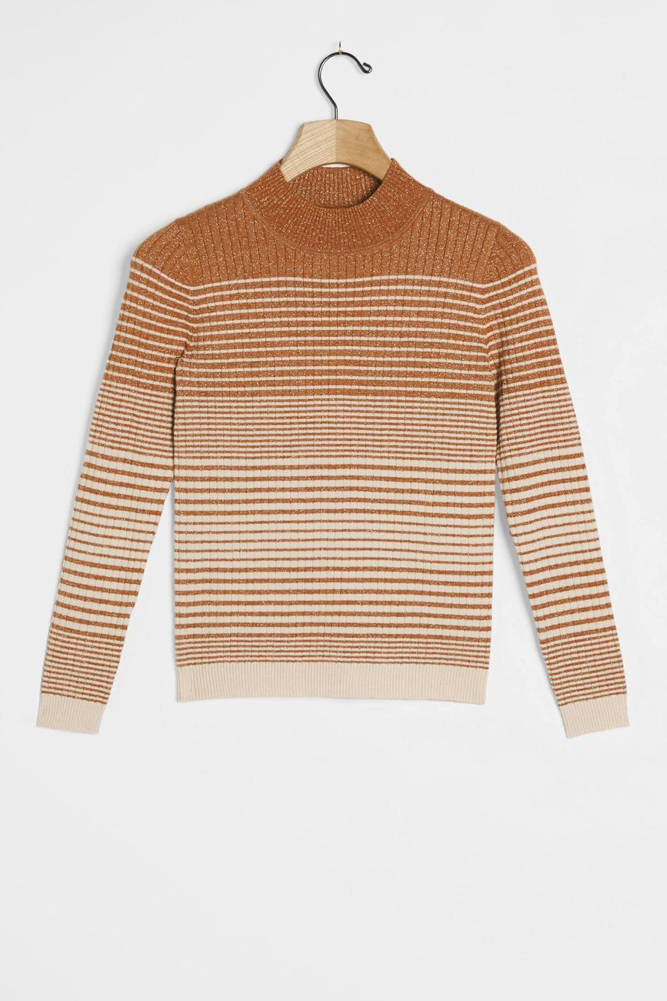"""<h2>Bonnie Shimmer Mock Neck Sweater<br></h2><br>The vintage school-girl aesthetic gets a major upgrade thanks to shiny, shimmery Lurex threaded throughout the weave of this close-cropped pullover.<br><br><strong>Heartloom</strong> Bonnie Shimmer Mock Neck Sweater, $, available at <a href=""""https://go.skimresources.com/?id=30283X879131&url=https%3A%2F%2Fwww.anthropologie.com%2Fshop%2Fbonnie-shimmer-mock-neck-sweater%3Fcategory%3Dtops-sweaters%26color%3D025%26type%3DSTANDARD%26quantity%3D1"""" rel=""""nofollow noopener"""" target=""""_blank"""" data-ylk=""""slk:Anthropologie"""" class=""""link rapid-noclick-resp"""">Anthropologie</a>"""