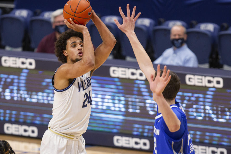 Villanova forward Jeremiah Robinson-Earl (24) shoots over Creighton center Ryan Kalkbrenner (32) during the first half of an NCAA college basketball game Wednesday, March 3, 2021, in Villanova, Pa. (AP Photo/Laurence Kesterson)