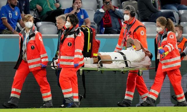 Italy's Leonardo Spinazzola is carried off on a stretcher
