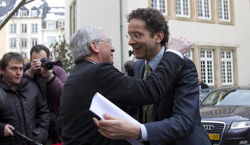 Luxembourg's Prime Minister and head of the eurogroup Jean-Claude Juncker, left, greets Dutch Finance Minister Jeroen Dijsselbloem in Luxembourg on Friday, Jan. 18, 2013. The outgoing leader of the group of finance ministers from the 17 European Union countries that use the euro is meeting with Jeroen Dijsselbloem on Friday, another indication the Dutch finance minister will take the post next week. (AP Photo/Virginia Mayo)