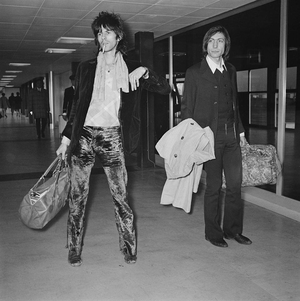 <p>Keith Richards and Charlie Watts of rock band The Rolling Stones at Heathrow Airport upon their return from the States, London, UK, 8th December 1969.</p>