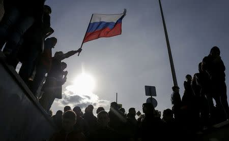 FILE PHOTO: Opposition supporters attend rally in Moscow