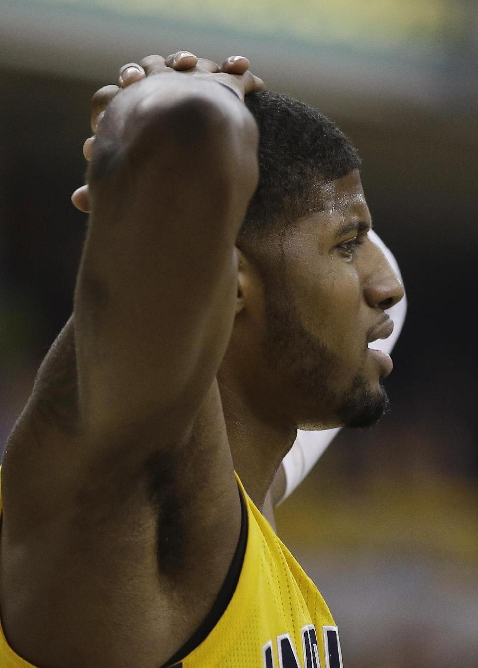 Indiana Pacers' Paul George reacts after being called for a foul during the first half in Game 1 of an opening-round NBA basketball playoff series against the Atlanta Hawks, Saturday, April 19, 2014, in Indianapolis. (AP Photo/Darron Cummings)