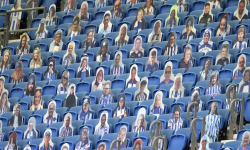 Cutout photos of Brighton fans fill the empty stands during the English Premier League soccer match between Brighton & Hove Albion and Arsenal at the AMEX Stadium in Brighton, England, Saturday, June 20, 2020. (Richard Heathcote/Pool via AP)