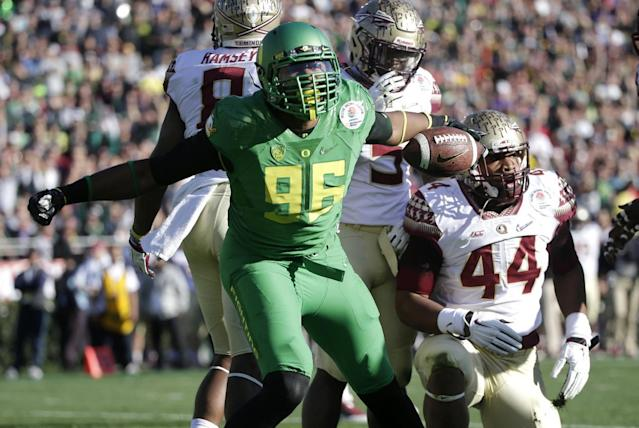 Oregon's Christian French, left, celebrates after scoring a 2-point conversion against Florida State during the first half of the Rose Bowl NCAA college football playoff semifinal, Thursday, Jan. 1, 2015, in Pasadena, Calif. (AP Photo/Jae C. Hong)