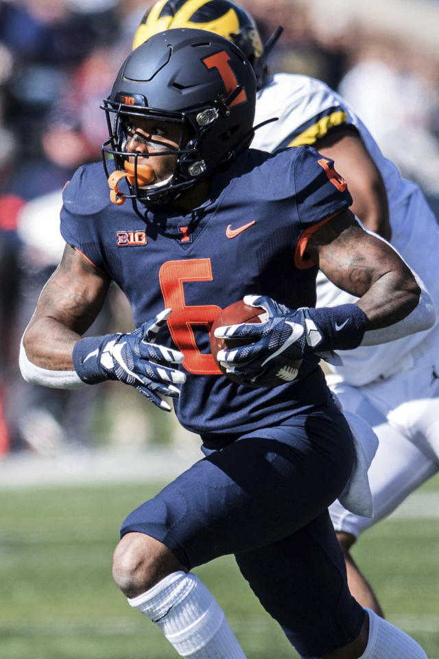 Illinois' Dominic Stampley (6) runs the ball in the second half of an NCAA college football game against Michigan, Saturday, Oct. 12, 2019, in Champaign, Ill. (AP Photo/Holly Hart)
