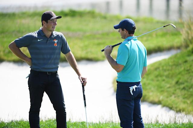"""<div class=""""caption""""> Viktor Hovland and <a class=""""link rapid-noclick-resp"""" href=""""/pga/players/8016/"""" data-ylk=""""slk:Rory McIlroy"""">Rory McIlroy</a> talk during a practice round prior to the 2019 U.S. Open at Pebble Beach. </div> <cite class=""""credit"""">Ross Kinnaird/Getty Images</cite>"""