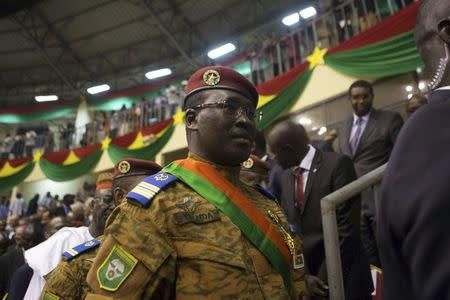 Burkina Faso's Prime Minister Lieutenant Colonel Isaac Zida attends the swearing-in ceremony of newly named President Michel Kafondo in Ouagadougou November 21, 2014. REUTERS/Joe Penne