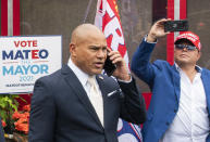 New York City mayoral candidate Fernando Mateo speaks on his mobile as he departs a campaign event where Michael Flynn, former national security adviser to former President Donald Trump, endorsed him on Thursday, June 3, 2021, in Staten Island, N.Y. (AP Photo/Eduardo Munoz Alvarez)