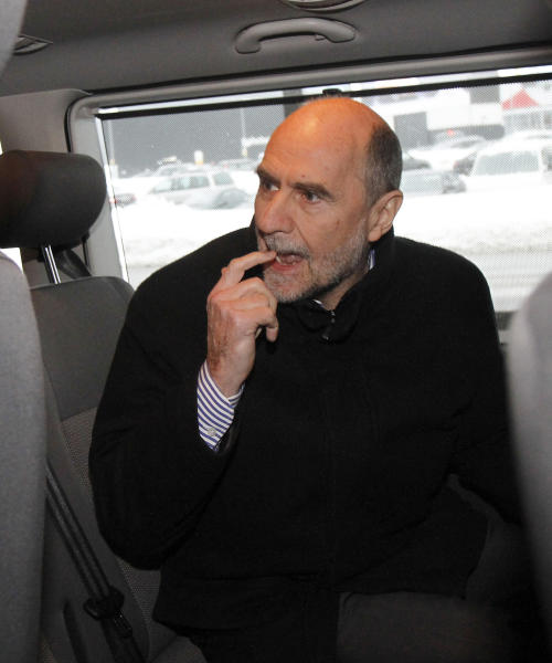 Herman Nackaerts, Deputy Director General and Head of the Department of Safeguards of the International Atomic Energy Agency, IAEA, sits in a car after his arrival from Iran at Vienna's Schwechat airport, airport, Austria, Friday, Jan. 18, 2013. (AP Photo/Ronald Zak)