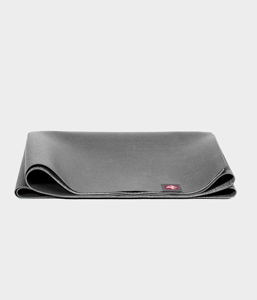 "<p>When hunting for a workout mat, I wanted two thing: something I didn't have to roll up (because I don't like the way they store), and something large. This <a href=""https://www.popsugar.com/buy/Manduka-Superlite-Yoga-Pilates-Travel-Mat-548331?p_name=Manduka%20Superlite%20Yoga%20and%20Pilates%20Travel%20Mat&retailer=amazon.com&pid=548331&price=44&evar1=fit%3Aus&evar9=45999467&evar98=https%3A%2F%2Fwww.popsugar.com%2Ffitness%2Fphoto-gallery%2F45999467%2Fimage%2F45999930%2FManduka-Superlite-Yoga-Pilates-Travel-Mat&list1=shopping%2Camazon%2Ceditors%20pick%2Cworkouts%2Cfitness%20gear%2Chome%20workouts%2Cfitness%20shopping&prop13=api&pdata=1"" rel=""nofollow"" data-shoppable-link=""1"" target=""_blank"" class=""ga-track"" data-ga-category=""Related"" data-ga-label=""https://www.amazon.com/Manduka-SuperLite-Travel-Pilates-1-5mm/dp/B07NH8VGLG?ref_=ast_sto_dp&amp;th=1"" data-ga-action=""In-Line Links"">Manduka Superlite Yoga and Pilates Travel Mat</a> ($44) fit both my requirements. I love that I can fold it up like a towel and throw it under my coffee table when I'm done.</p>"