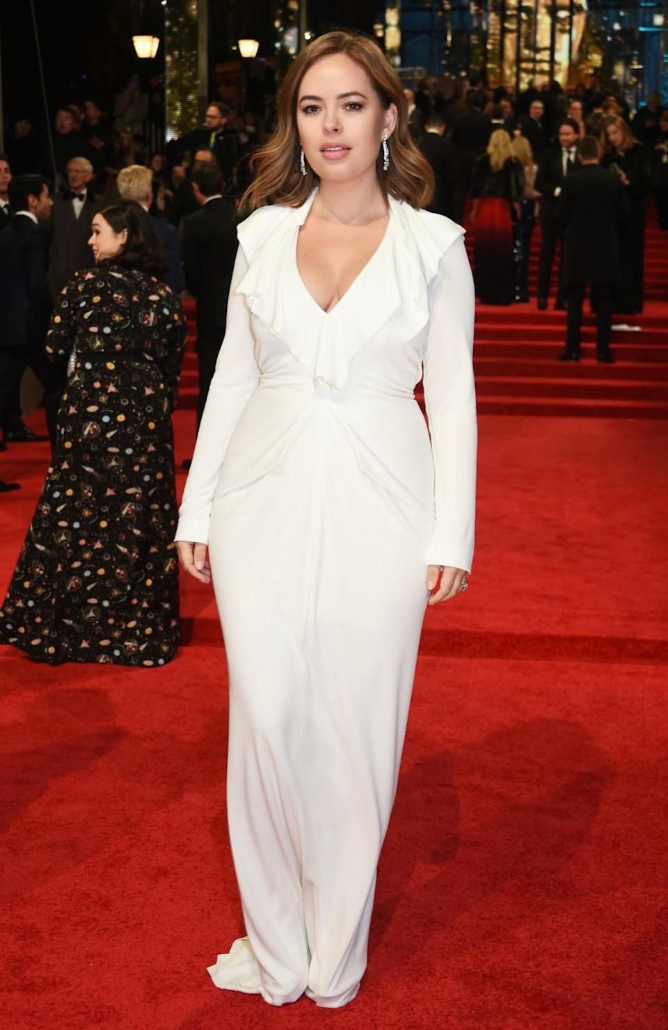 <p>The vlogger chose a striking white Roland Mouret gown for the event. <i>[Photo: Getty]</i> </p>