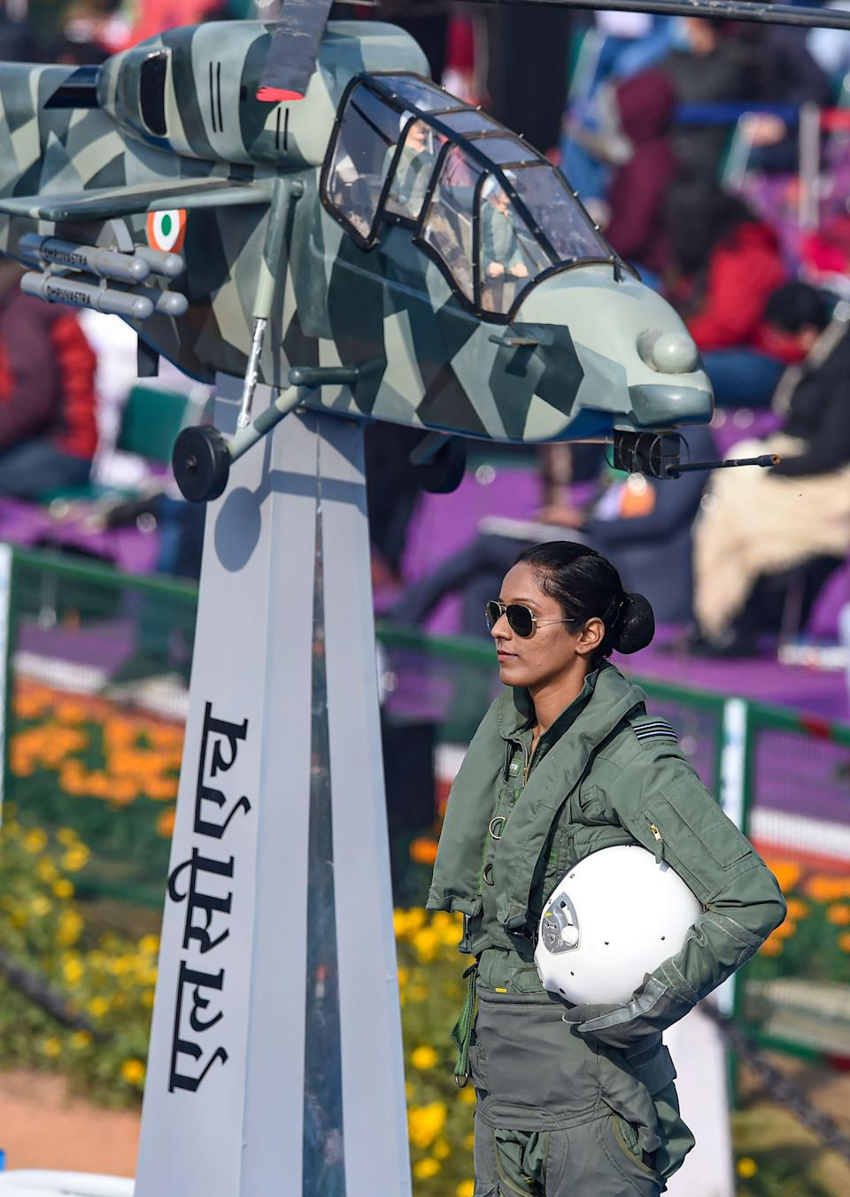 New Delhi: Flight lieutenant Bhawana Kanth stands on the Indian Air Force (IAF) tableau as it moves past Rajpath, during the 72nd Republic Day celebrations in New Delhi, Tuesday, Jan 26, 2021. Kanth became the first woman fighter pilot to take part in the January 26 ceremonial event.