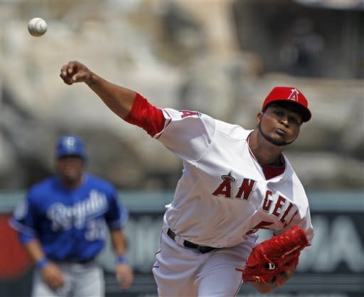 Los Angeles Angels starter Ervin Santana pitches to the Kansas City Royals in the first inning of a baseball game at Anaheim, Calif., Sunday, April 8, 2012. (AP Photo/Reed Saxon)