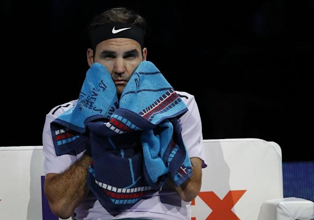 Roger Federer has always thrived on the indoor hard-court used at London's O2 Arena (AFP Photo/Adrian DENNIS)