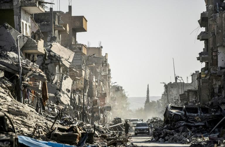 Heavily damaged buildings are seen in Raqa on October 20, 2017 after Islamic State group fighters were ousted from the Syrian city