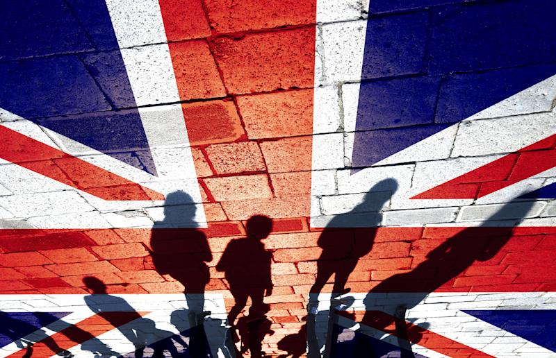 Group of people on Uk flag. (Photo: robertiez via Getty Images)