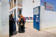 People stand during vaccination campaign against COVID-19 in Jendouba