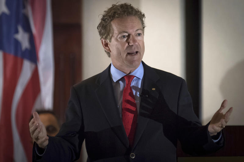 """In this Aug. 11, 2017 photo, Sen. Rand Paul, R-Ky., speaks to supporters in Hebron, Ky. A man has been arrested and charged with assaulting and injuring Rand Paul. Kentucky State Police said in a news release Saturday, Nov. 4, 2017 that Paul suffered injuries when 59-year-old Rene Boucher assaulted him at his Warren County home on Friday afternoon. The release did not provide details of the assault or the nature of Paul's injury. In a statement, Paul spokeswoman Kelsey Cooper said the Republican senator was """"fine."""" (AP Photo/Bryan Woolston, file)"""