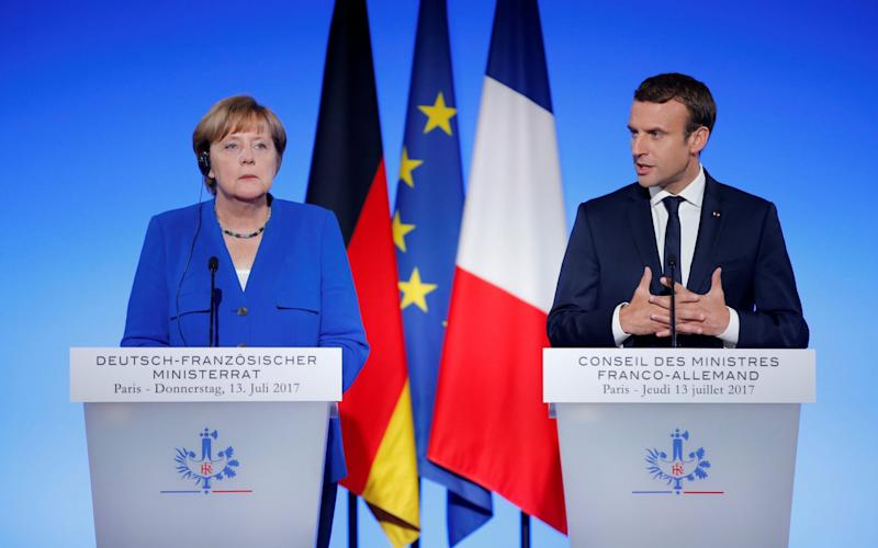 French president Emmanuel Macron and German chancellor Angela Merkel. Their countries both saw 0.6pc growth in the last three months of 2017 - REUTERS