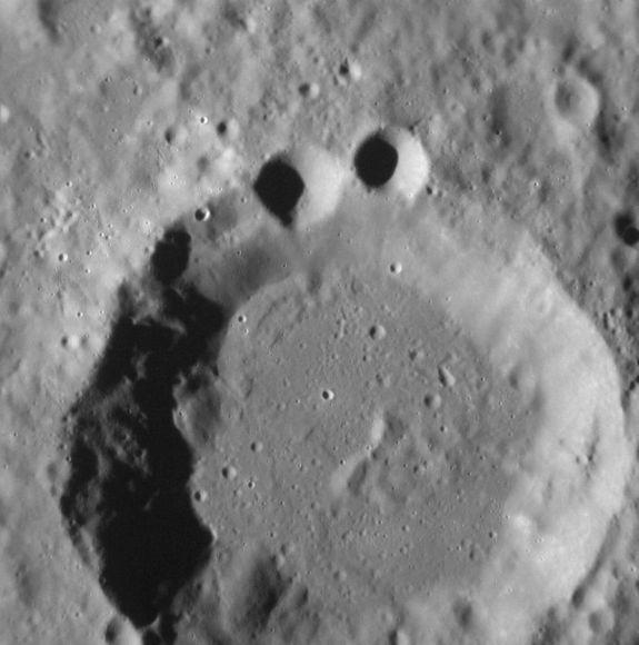 Mercury Craters Look Like Cookie Monster in NASA Photo