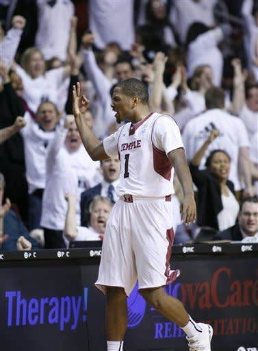 Temple's Khalif Wyatt (1) puts up three fingers after he scored against VCU in the second half of an NCAA college basketball game on Sunday, March 10, 2013, in Philadelphia. Temple won 84-76. (AP Photo/H. Rumph Jr)