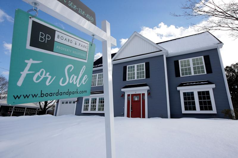 In this Thursday, Feb. 21, 2019 photo a newly constructed home sits near a sign, in Natick, Mass. On Thursday, Feb. 28, Freddie Mac reports on this week's average U.S. mortgage rates. (AP Photo/Steven Senne)
