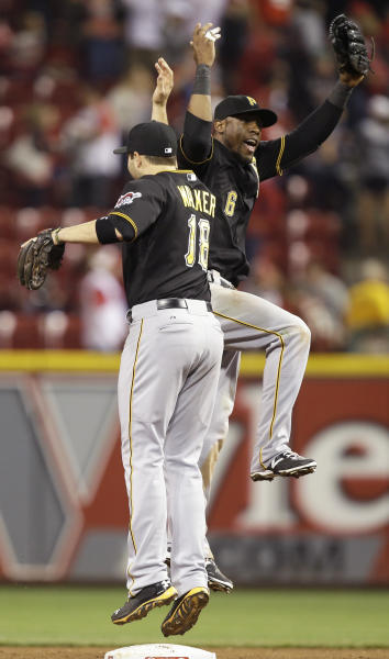 Pittsburgh Pirates left fielder Starling Marte (6) celebrates with second baseman Neil Walker (18) after the Pirates defeated the Cincinnati Reds 4-1 in a baseball game, Friday, Sept. 27, 2013, in Cincinnati. (AP Photo/Al Behrman)